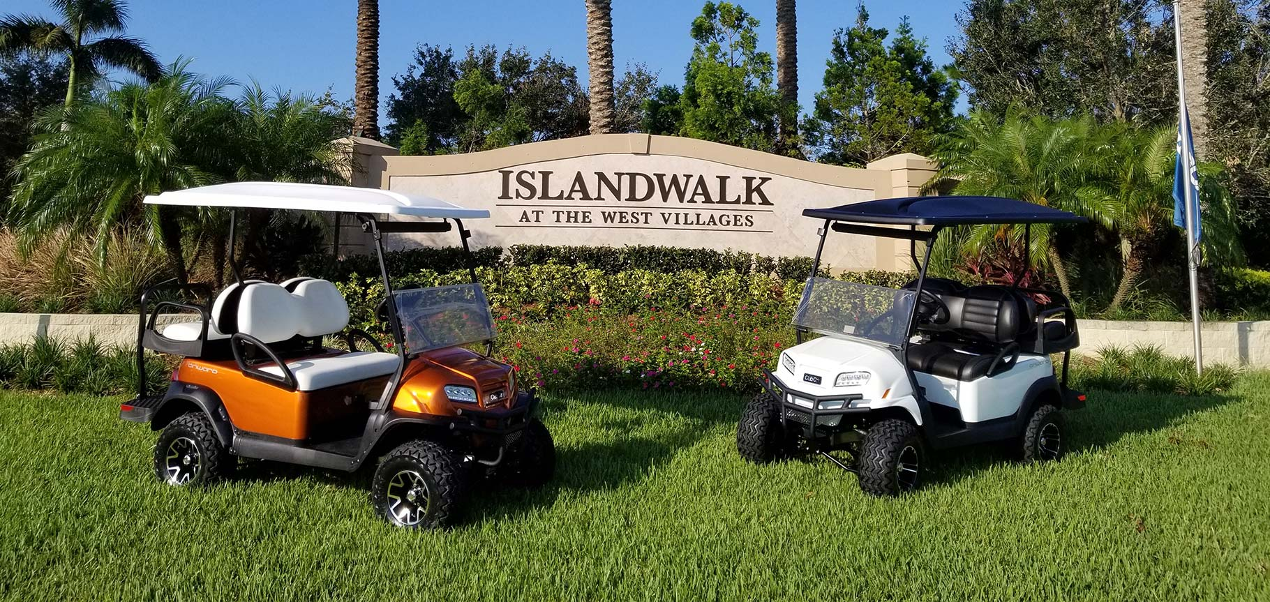 Islandwalk entrance sign with golf carts image