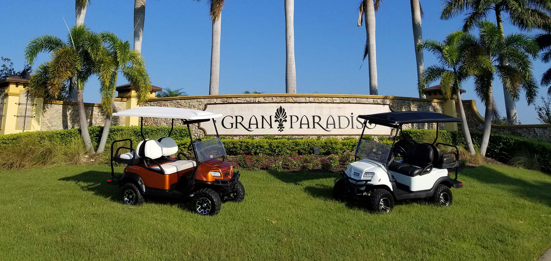 Gran Paradise entrance sign with golf carts image