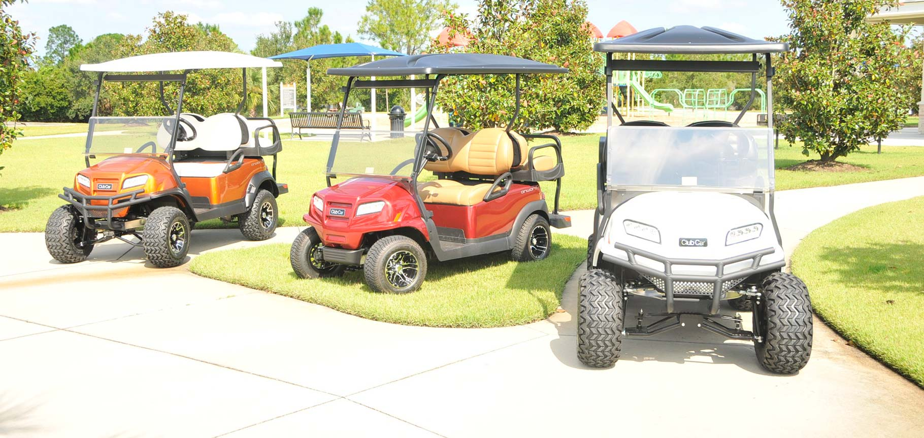 Line of 3 golf carts image