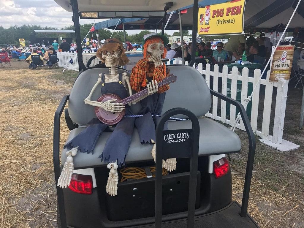 Fake skeletons on back of golf cart image