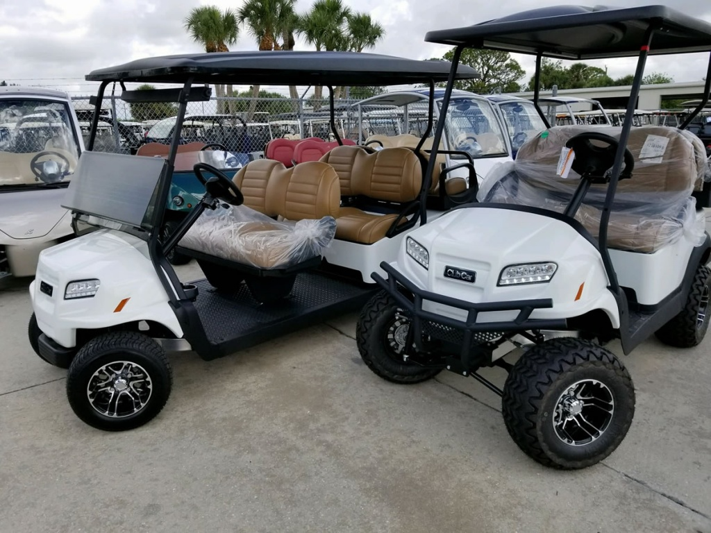 Two white golf carts image