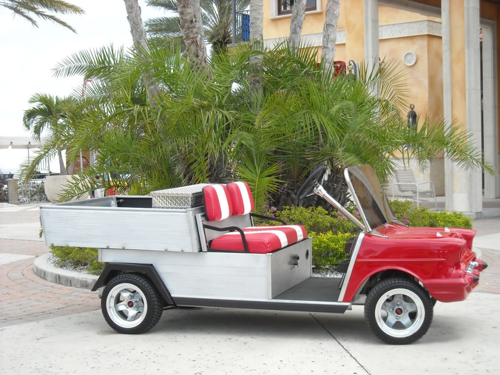 Red golf cart with storage bed image