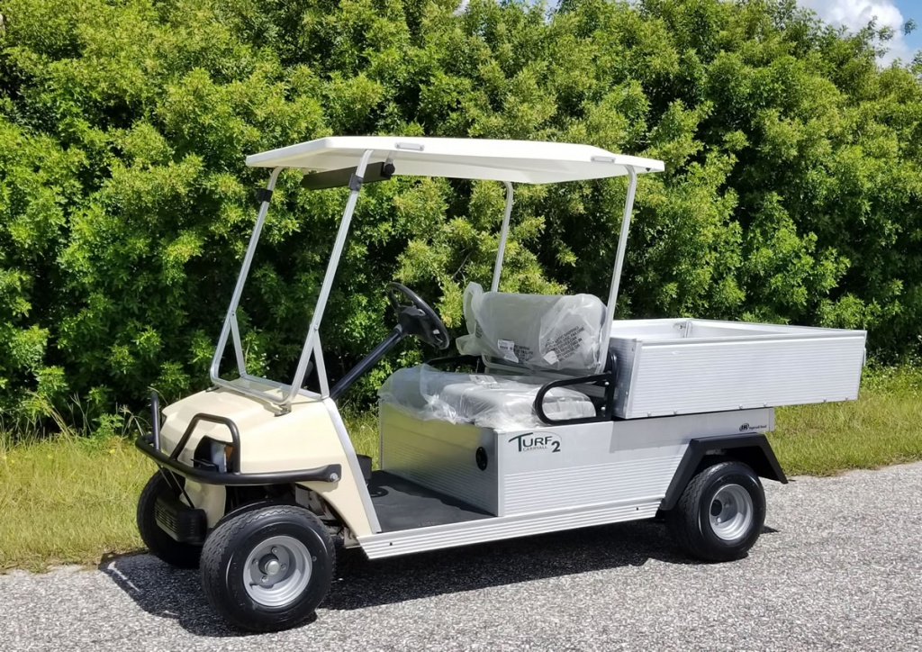 White golf cart with storage bed image