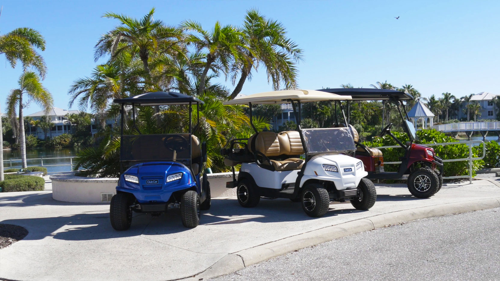 Three golf carts on sidewalk image