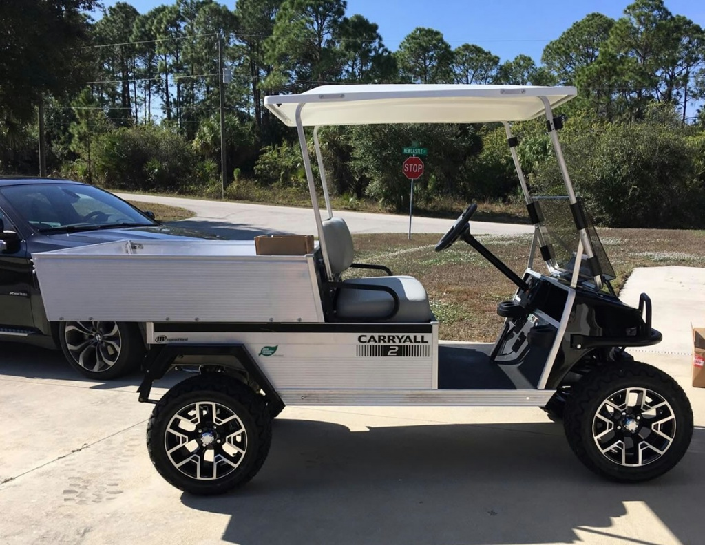 black golf cart with storage bed image