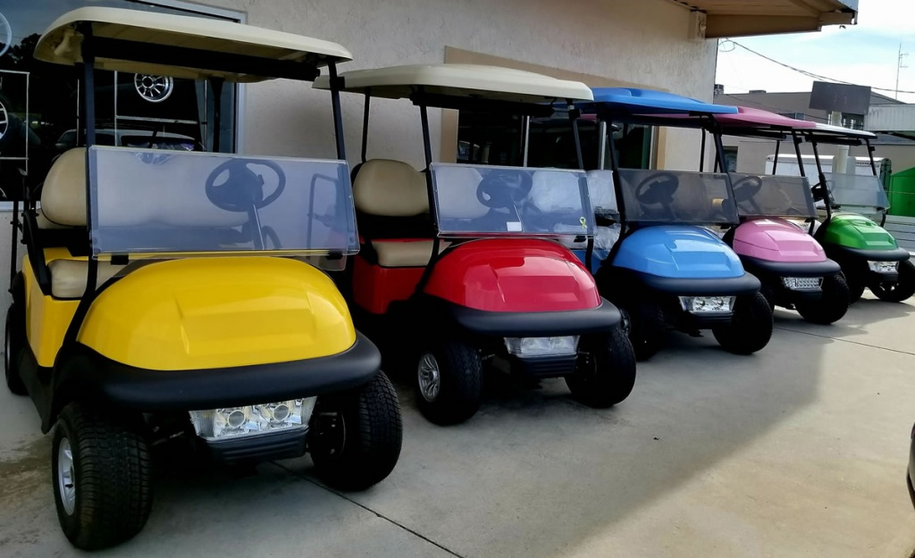 Line of different colored golf carts image